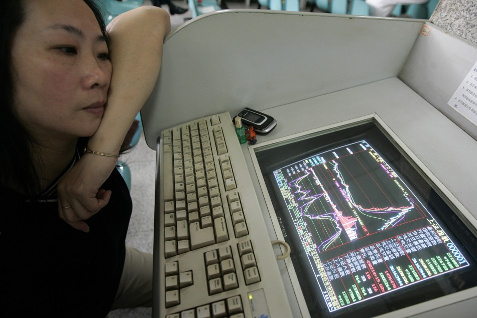 woman-watches-shanghai-composite-index-computer-screen-shanghai